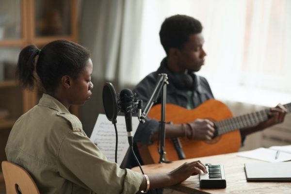 African-American Couple Recording Music Together