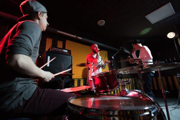 Band Recording Music in Studio